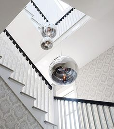 """Gwyneth Paltrow's staircase in the Hamptons. I """"stole"""" her wallpaper for my bedroom. Her Wallpaper, Hallway Wallpaper, Damask Wallpaper, White Wallpaper, Die Hamptons, 25 Beautiful Homes, New York Homes, Chandelier, Design Blog"""