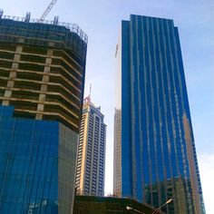 Morning hustle.  #architecture #building #construction #structure #citylife #cityscape #blueonblue #city #citylandscape #earthpics #earth #earthphotography #latepost #phonephotography #photo#reflection #igers #igdaily #travel #traveller #wanderer #wanderlust #destinations #beautifuldestinations