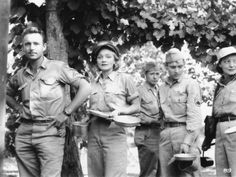 Marlene Dietrich in the chow line with the 47th Bombardier Group in Sicily, 1944. For her war work, Dietrich was awarded the Medal of Freedom by the US Congress and the Legion d'honneur by the French government.