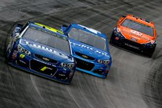 Jimmie Johnson Photos Photos - Jimmie Johnson, driver of the #48 Lowe's Chevrolet, leads a pack of cars during the Monster Energy NASCAR Cup Series Food City 500 at Bristol Motor Speedway on April 24, 2017 in Bristol, Tennessee. - Monster Energy NASCAR Cup Series Food City 500