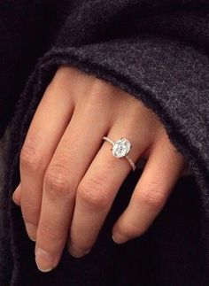 Dream ring: 2 carat oval set in a rose gold, thin, diamond band. Lovely, delicate & perfect.