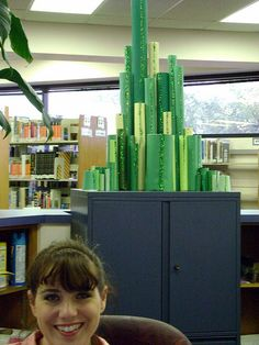 Natalie at the Information desk - emerald city card board tubes