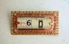 pin with section of vintage carpenter's measuring stick, hand stamped copper and textured brass