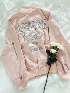 Swooning over this dreamy bomber jacket is what you will be doing. Features front zipper, pockets and ribbed cuffs. Comes in Pink. 100% Polyester