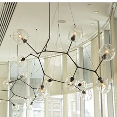 Lindsey Adelman Designed Lighting.  Truly function and form have met. My dream piece.