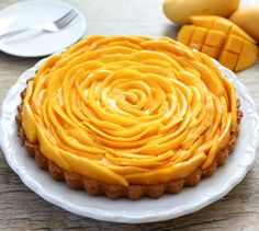 This Mango Mousse Tart is gorgeous...But honestly I'll probably never be able to make it look that good!