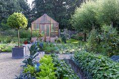 Phillipe Perdereau | Focus on garden - Fine Photography.   Greenhouse inside fenced garden