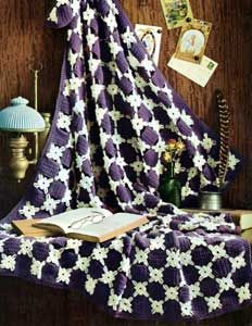 Deep violet and white daisies make a striking pair in this vintage crochet afghan.