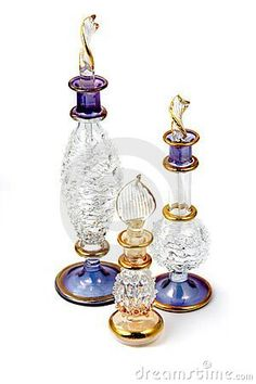 Three perfume  glass bottles