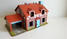 The first time I found one of these in an antique shop I literally fell to my knees in front of it!!  The memories came flooding back!!!  <3  Vitnage Fisher price tudor doll house vintage toy 80's toy with little people