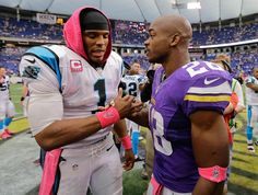 Minnesota Vikings running back Adrian Peterson, right, shakes hands with  Carolina Panthers quarterback Cam Newton