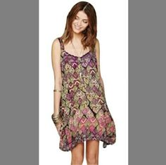 Free People ONE Dress. Flowy dress. Open back. 100% rayon. Purple and green print. Shows no sign of ware. Free People Dresses Asymmetrical
