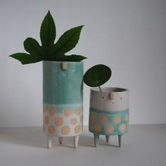 Shiny off white and matt turquoise green glaze. Staffordshire stoneware clay, hand built, with hand glazed detail. Tall - H 18cm + W 8cm Short - H1...