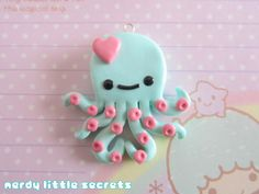 Kawaii Pastel Chibi Octopus Necklace (Mint & Pink). $11.00, via Etsy.
