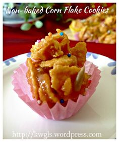 corn flakes cookies 45 –60 grams of corn flake  45 grams of peanut butter 45 grams of castor sugar 45 grams of honey or corn syrup Some small paper cups