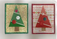 Christmas cards made with paint-chip samples and buttons on cardstock and glitter.