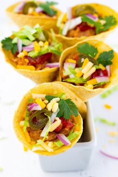 Put a spin on your regular tacos by making these fun Taco Cones!!  Just bake the tortillas in the oven and then fill them with your favorite taco ingredients! (gluten free, vegan)