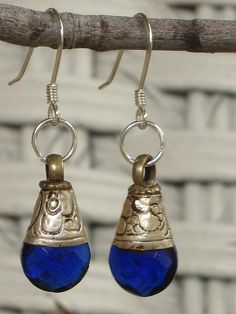 Beautiful Tibetan silver earrings with cobalt blue cubic zirconia earrings. Makes a great gift or treat for yourself!  All findings are sterling silver.  Length: 38 mm  Width: 10 mm    Modern Tibetan Silver Jewelery tends to be a base iron casting, overla fashion jewellery to suit any