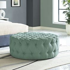 Amour Fabric Ottoman, Laguna - Inspire your decor with the Amour Round Ottoman. Fashionably chic with a refreshing look, Amour features a luxuriously tufted round design with dense foam padding, fine fabric upholstery, and non-marking black plastic legs. Rest your feet, display some favorite magazines, and accent your bedroom, living room, lounge or meeting area decor with this stylish well-designed addition to your modern home or office. Set Includes: One - Amour Ottoman. Material: chair…
