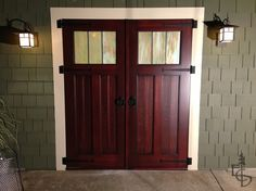 Pic 1 - Carriage garage doors can be used as an alternative to old, tired sliding glass doors. http://www.evergreencarriagedoors.com