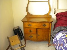 Birds Eye Maple dresser, the frame along the back would hold your washcloth and or towel. The basin would have sat on top. Bought this in Faribault MN, when hubby was in Korea. 2003-2004, about 75 years old