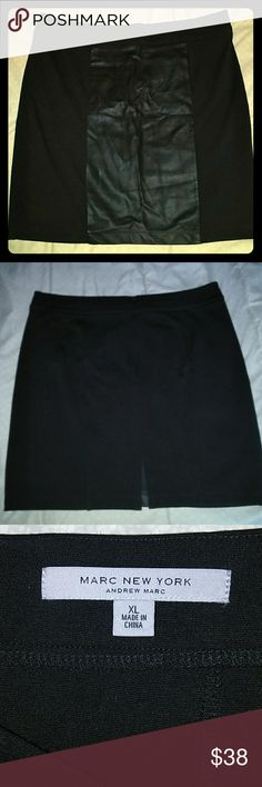 Andrew Marc New York Black Skirt XL High quality black skirt with soft black leather panel in front ... Stylish & Slimming ... By designer Andrew Marc New York ...back zipper and 4 inch slit at bottom ... 19 inch waistband to hem ...size XL ... Good condition ...     You will love it! Andrew Marc Skirts Midi
