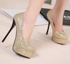 Image from http://i01.i.aliimg.com/wsphoto/v0/745307557/free-shipping-sexy-high-heels-fashion-glitter-wedding-shoes-woman-ladies-2013-spring-new-arrive-platform.jpg.