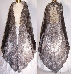 This antique Victorian Civil War era black chantilly lace mantilla shawl dates from the 1860s. It is made of a sheer fine delicate black net French chantilly lace, with a swiss dot, floral foliage leaf pattern outlined in black threads with detailed shading effects and a beautiful decorative scalloped border edging.