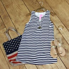 Come Sail Away Dress is a must have! This fully lined dress feature classic navy and ivory stripes with gentle darting for a feminine fit.