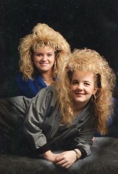 I don't know what is up with the girl on the right's hair, but it seems to be defying gravity: | 25 Photos Of '80s Hairstyles So Bad They're Actually Good