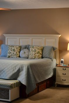 Old door turned headboard, how fabulous does this look!