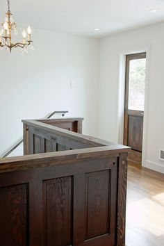 Up-cycled five panel doors as stairway railing for the landing ~ from Chic Design Investments: Port House