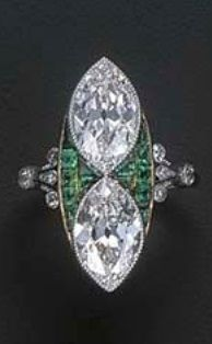 A BELLE EPOQUE DIAMOND AND EMERALD RING, FRENCH, CIRCA 1915. The two marquise-cut diamonds set vertically with calibré-cut emeralds between, to the diamond trefoil shoulders and plain hoop, mounted in platinum and gold, with French assay mark for gold, numbered to the hoop, with blue case by Boucheron. #BelleÉpoque #ring