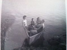 Vintage photo of three women in a canoe