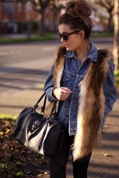delicious outfit! fur over denim with a big bag, messy updo and dark shades