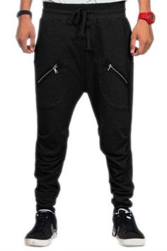 "Black Twin Zipper Streetwear Pants at Threader® Streetwear, 100% cottom unisex comfortable low crotch ""harem"" black streetwear sweatpants with two zipper pockets on the front and one zipper pocket on the back to tie it all together.     $45.00"