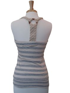 Gray and ivory striped tank, with braided rope down the back. It runs a little bit on the small side.