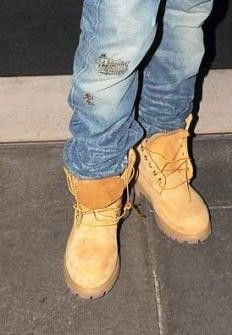 Jeans tucked in a pair of undone Timberland boots - hip hop style of the late 80s