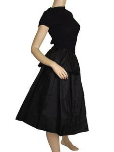 Cute 1940s skirt made up of 3 layers of crisp black silk taffeta . The top ruffle looks a bit like a peplum on a jacket. It has a set in waistband with a black metal zipper and button closing. Unlined