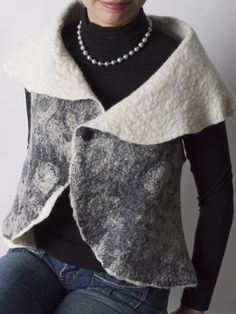 # Felted shawl collar vest.