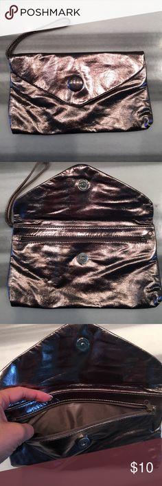 Gunmetal grey wristlet/ clutch Has zipper and a button so you won't lose anything! Offers welcomed!  H&M Bags Mini Bags