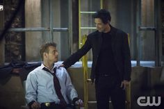 """The Flash -- """"Grodd Lives"""" -- Image FLA121B_0120b -- Pictured (L-R): Rick Cosnett as Detective Eddie Thawne and Tom Cavanagh as Harrison Wells -- Photo: Cate Cameron/The CW -- © 2015 The CW Network, LLC. All rights reserved.pn"""