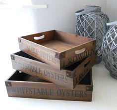 For lovers of vintage living a Vintage Wooden Tray will make the perfect gift.These vintage style wooden trays made from reclaimed pine have high sides and gentle curved handle holds. Stained to create a stunning vintage effect with stencilled writing, these trays should not be hidden away. These stylish Vintage Wooden Trays come in three different sizes and nest together to create a stunning effect. Each tray has a reclaimed metal bracket at each corner which adds to it's character.Made to…