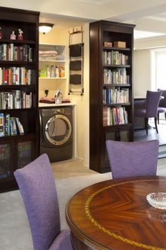 Laundry room hidden by a movable bookcase... How awesome is that?