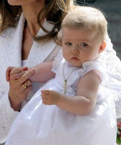 Infanta Leonor being held by her mother during her Presentation to the Virgin Mary, a tradition of the Spanish Royal Family, at the Basilica of Our Lady of Atocha in Madrid, 7 June 2006.