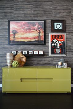 That dressor, that wall and the idea of the graphic posters (maybe not the choice), fabulous