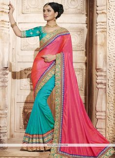 True splendor can come out of your dressing trend with this blue and rose pink art silk and handloom silk half n half saree. This desirable attire is displaying some remarkable embroidery done with em...