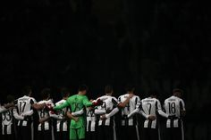 Juventus players pause for a one minute silence in honour of the victims of a plane crash, which was carrying aboard it members of the Brazilian team Chapecoense Real, when it crashed in Colombia on November 29, ahead of the UEFA Champions League football match Juventus Vs GNK Dinamo Zagreb on December 7, 2016 at the 'Juventus Stadium' in Turin.  / AFP / MARCO BERTORELLO