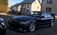 BMW e36 coupe on OEM BMW Styling 37 (M Parallel) wheels