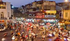 Hanoi, Vietnam. if there is anything i remember from my trip to Hanoi & HCMC was this mob of Honda bikes and delicious pho noodles. visited in '07.